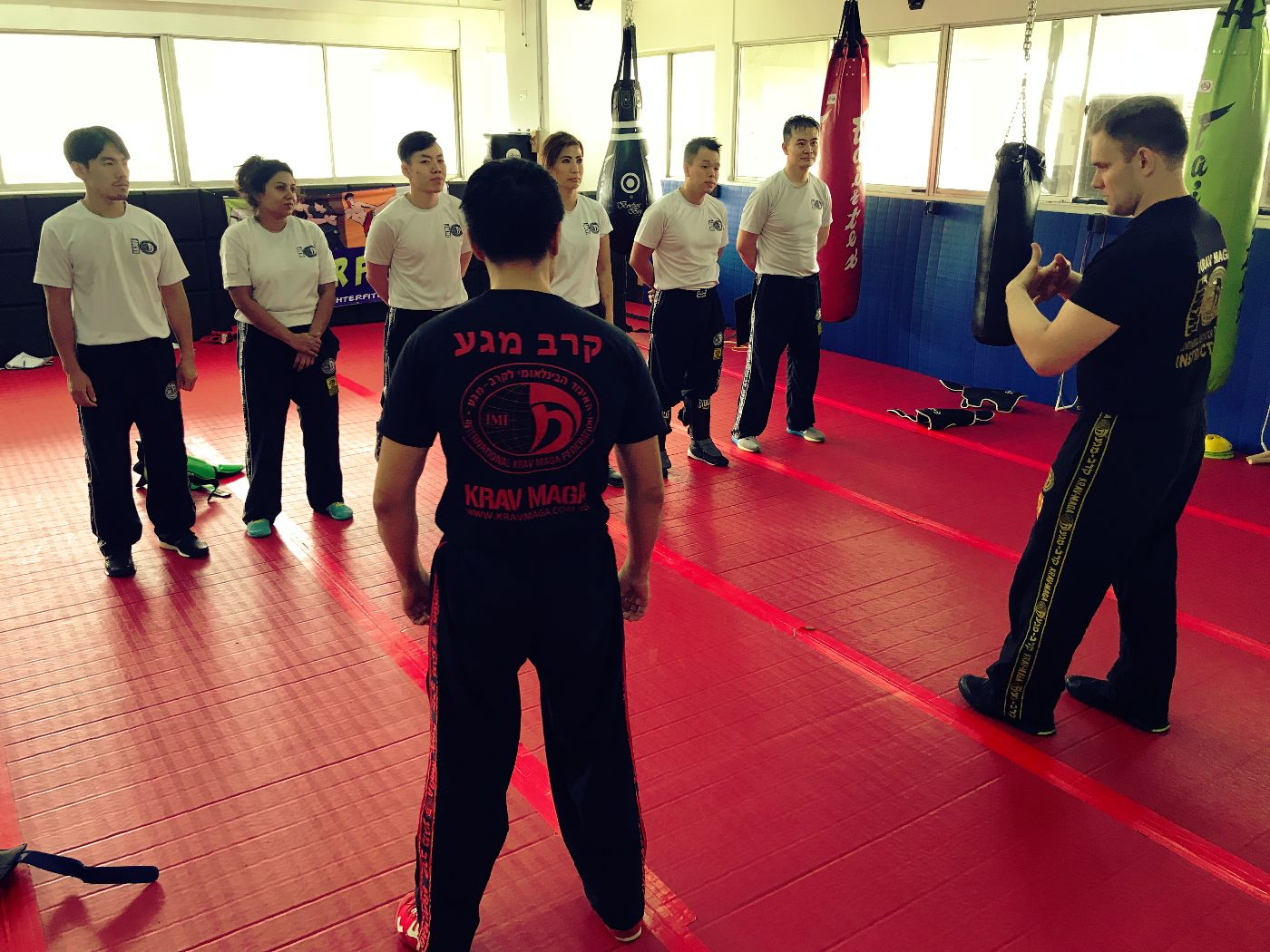 Krav Maga Instructor explaining to Krav Maga students how the technique works